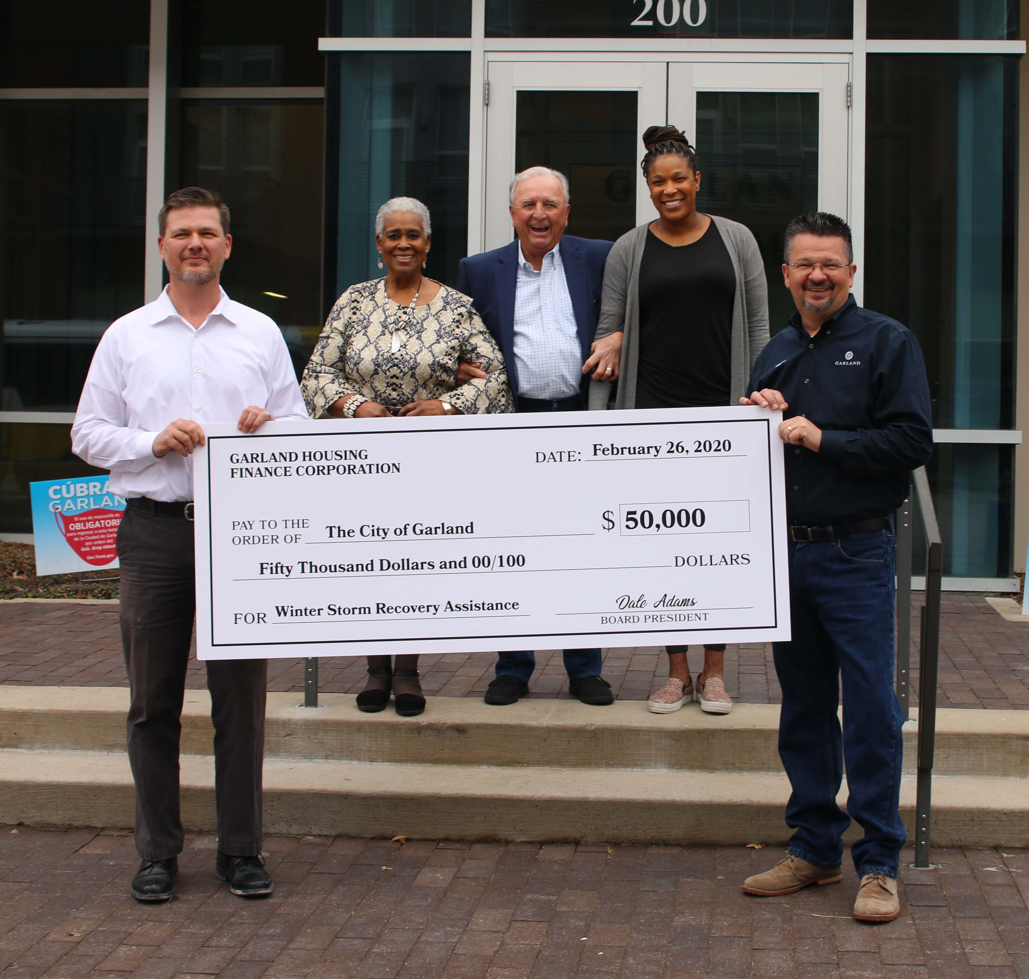 The Garland Housing Finance Corporation presented a $50,000 donation for winter storm relief.